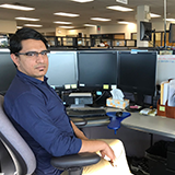 Parik at his desk